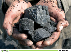 Hands filled with coal.